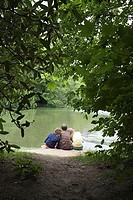 Teenagers resting near a lake