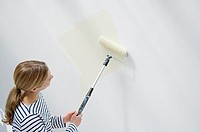 Woman painting a wall (thumbnail)