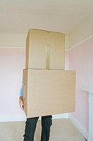 Person holding cardboard boxes