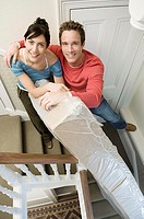 Couple on stairs with mattress