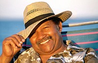 smiling man in a straw hat