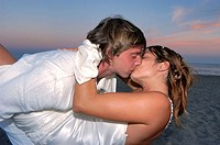 Happy young newly married couple kissing