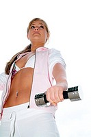 A young woman in bikini and jacket exercises while she lifts the dumbbell.