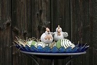 Striped decorative eggs and figures for Easter.