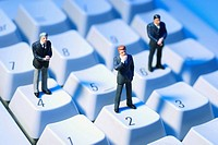 Miniature Businessmen on Keyboard