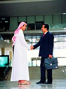 Handshake between Arab businessmen