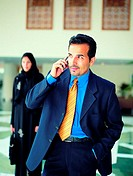 Arab businessman using mobile phone (thumbnail)