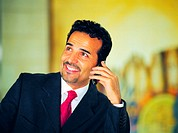 Arab businessman using mobile phone