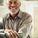 Smiling Man in Button Front Shirt