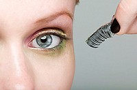 Woman holding a false eyelash