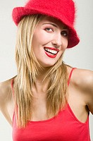 Woman wearing a red hat and lipstick