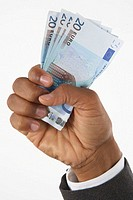 Businessman holding Euro currency (focus on currency)