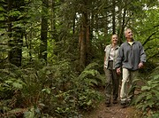 USA, Washington, mature man and woman walking on footpath
