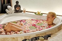 Woman relaxing in a fragrant bath