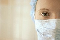 Woman wearing surgical mask and cap (thumbnail)