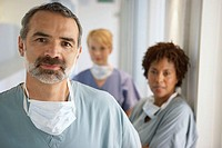 Doctor with nurses in background (thumbnail)