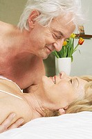 Romantic senior couple in bed