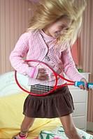 Girl Playing Badminton Racket