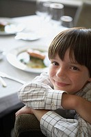 Young Boy Sitting at Table for Meal