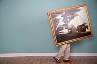 Man Carrying Large Painting