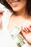 Woman Pulling Bills Out of Her Brassiere
