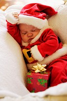 Sleeping Baby Boy in Santa Claus Costume