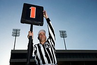 Referee Holding Down Marker