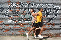 Two Jogger in Front of Wall
