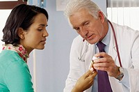 Doctor Explaining a Prescription