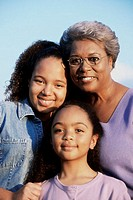 Portrait of a grandmother with her two granddaughters