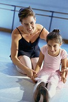 Ballet teacher training a girl