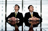 Two Businessmen in Conference Room Looking up