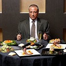 Businessman Having Dinner