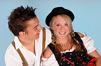 Young couple wearing bavarian costume
