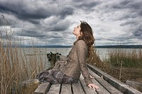 Woman sitting on jetty