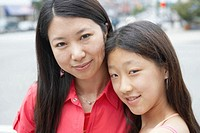Mother and daughter (11-13) smiling, portrait