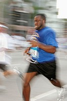 Corporate Fitness Run, finish line, Black man crosses. Biscayne Boulevard. Miami. Florida. USA.