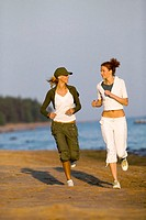 Two women jogging on beach