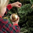 Young Girl Admiring Christmas Ornament
