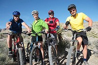 Friends Posing on Mountain Bikes