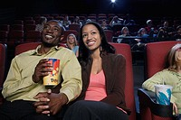 Couple Enjoying a Movie in Movie Theatre