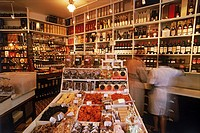 Inside small epicerie or delicatessen in Paris
