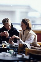 A happy young couple having drinks of hot chocolate together in casual eatery