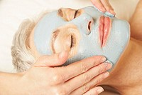 Woman Receiving a Facial Mask