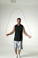 Man with skipping-rope in studio