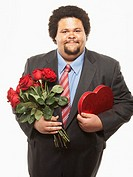 Romantic Businessman with Flowers and Candy
