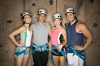 Four People in Front of Climbing Wall