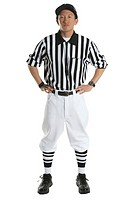 Young male referee, hands on hips, portrait