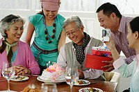 Senior Man with Family on Birthday