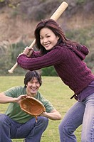 Couple Playing Baseball in Park